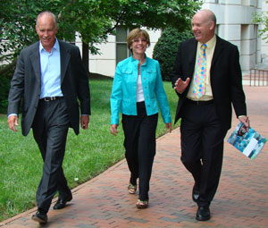 Dr. Jamie Bartram, right, chatted with Don and Jennifer Holzworth recently about plans for the Water Institute's October Water and Health Conference.