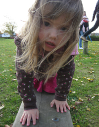 Three-year-old Emily Sandum enjoys a daily visit to the playground. Photo by Jenny Sandum.