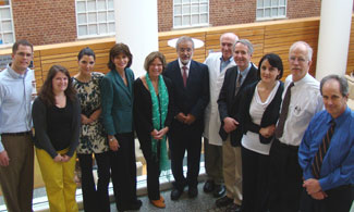 Dr. Faiz Kakar, sixth from left, visits with student and faculty members involved in global health issues.