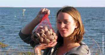 Anna Child shows off fresh clams that will be sold through Core Sound Seafood.