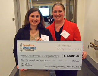 Liz Morris (left) and colleague Sarah Nilson, a student at N.C. State University, pose with their Carolina Challenge award for their company, Sanitation Creations. Photo by Patrick Vernon.