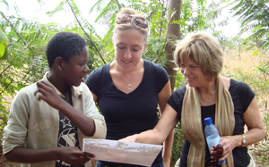 Dr. Peggy Bentley (right) has conducted research on infant and young child nutrition in several countries in which ChildFund's programs improve children's growth and development. In July 2010, Bentley visited a sustainable agriculture site in Malawi, Africa. With her is UNC alumna Kari Riggle (center), daughter of nutrition professor Linda Adair, PhD.