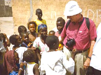 Dr. Donald Lauria greets children in Senegal