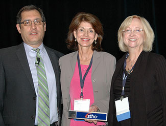 Dr. Leah Devlin (center) accepts award from ASTHO president Jose Montero (left) and Mary Mincer Hansen, president of the organization's alumni society.