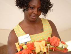 Sharon Brown arranges a bucket of eatable fruit