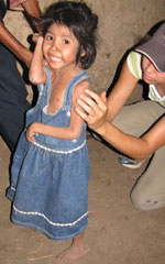 Edwards examines a malnourished girl in Apante, Nicaragua.
