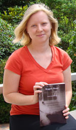 Emily Eidenier holds a copy of her book about the Rogers-Eubanks neighborhood in Orange Co., N.C.