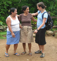 Garrett, right, stops for a conversation with two women in Honduras.
