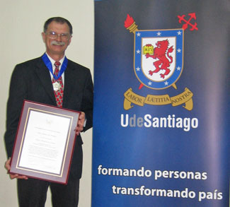 Dr. Anthony Hackney accepts University of Santiago's Medal of Distinction for his research and advocacy in Latin America.