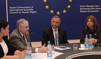 Clinical associate professor Dean Harris (second from left) speaks with government leaders in Azerbaijan.