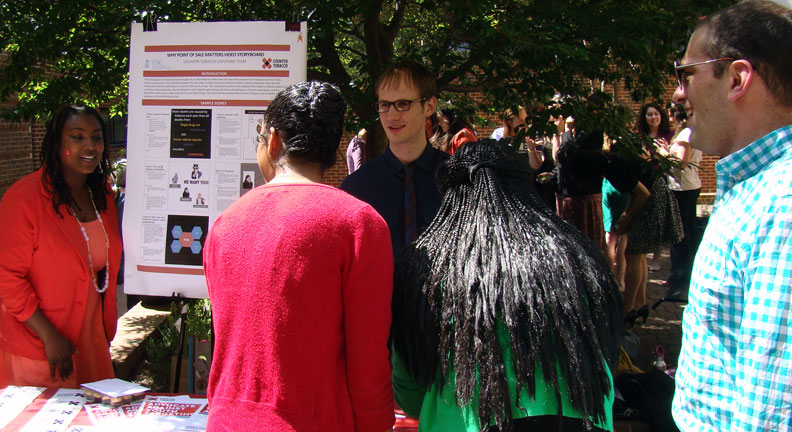 Students converse during a Capstone poster session.