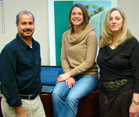 Dr. Rohit Ramaswamy (left) meets with research assistant Kate Barker, MPH, and Dr. Hollie Pavlica