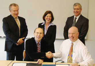 IAPMO officials met in March 2011 with Dean Barbara K. Rimer and Dr. Jamie Bartram. Left to right are Dr. Stu Asay, GP Russ Chaney (CEO), Rimer, Bartram and Pete DeMarco.