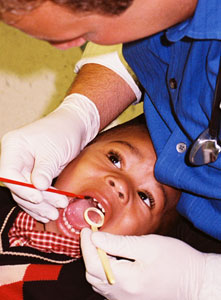 Dr. Adam Shapiro examines a boy's teeth
