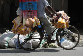 An entrepreneur distributes his wares in Dar es Salaam.