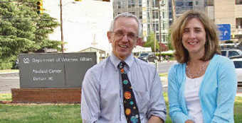 Dr. Morris Weinberger (left) and Dr. Deborah Tate visit the Veterans Affairs Medical Center in Durham, N.C.
