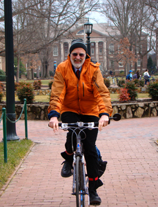Dr. Barry Popkin takes personally his professional campaign for good health, regularly biking to campus for exercise. (Note: Popkin removed his helmet to pose for this photo, but he never bikes without it.)