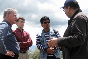 Don Lauria, PhD, retired professor of environmental sciences and engineering and EWB adviser, and Ryan Kingsbury, master's student and UNC EWB president, talk with members of Ecuadorian nonprofit Fundacion Natura about the problems that the communities of El Inga Bajo and El Inga Alto are having with their water system.