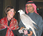 Dean Barbara K. Rimer is introduced to a falcon by her host, H.E. Majid Al Mansouri, Secretary General of the Environment Agency-Abu Dhabi.