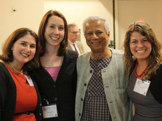 The UNC-born company Sanitation Creations placed third overall in a recent social business competition. Founder Liz Morris (left) and team members (l-r) Kristen Downs and Alison Sanders pose with Nobel laureate Muhammad Yunus at the event.