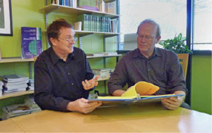 David Stone (left) and Dr. John Graham review accreditation materials for North Carolina health departments.