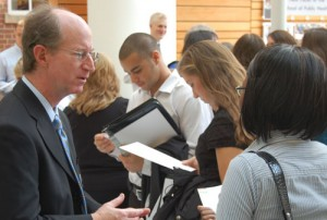 Dr. David Steffen speaks with a student at a leadership event.