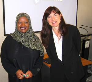 Dr. Jacqueline MacDonald Gibson (right) confers with colleague Rugaya Mohamed, from the Environment Agency-Abu Dhabi.