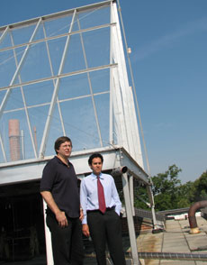 Drs. Ken Sexton and Will Vizuete (l-r) describe the operation of the smog chamber on top of UNC's McGavran-Greenberg Hall.