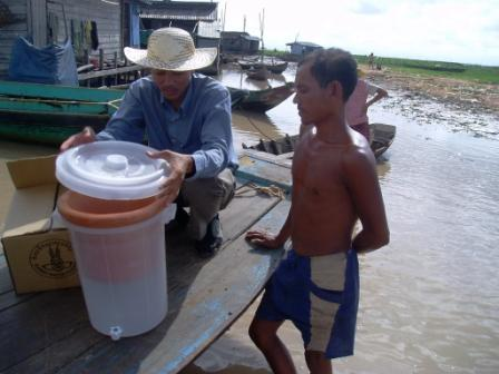 Distributing home water filtration systems in Cambodia (courtesy, then-ESE-doctoral-student Dr. Joe Brown).