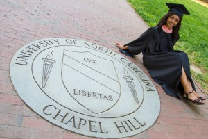 Amy Patel, MPH Class of 2014, poses by the UNC-Chapel Hill seal.
