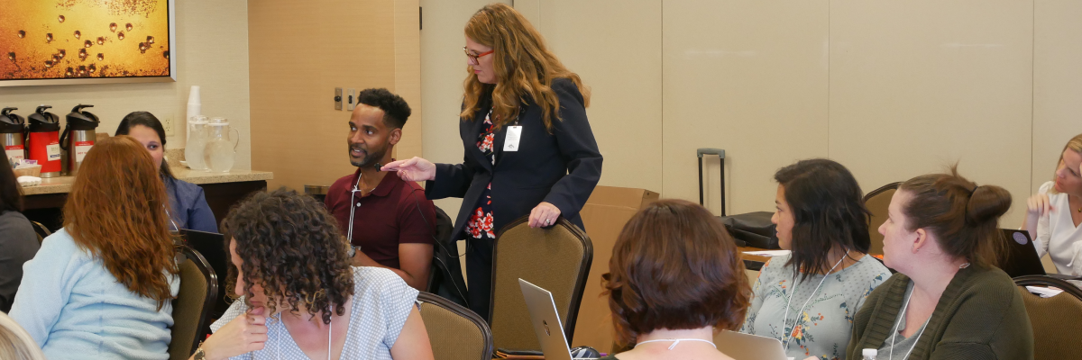 A student addressing a group of public health nurses during a 2019 PPPHN course