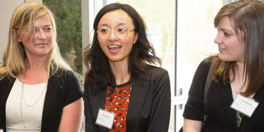 Xiaoqian Li announces practicum with CGBI. Kate Peterman, l, went to India and Alice Pollard, r, worked at Duke.