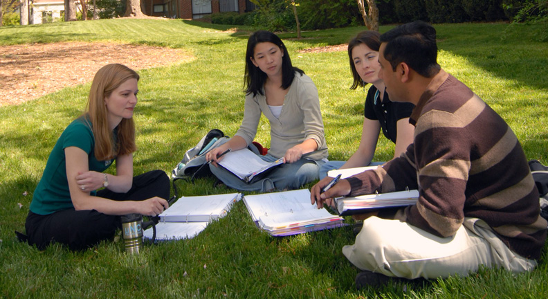 Amy Herring (left), associate chair of the biostatistics department, converses with students on the front lawn of McGavran-Greenberg Hall.