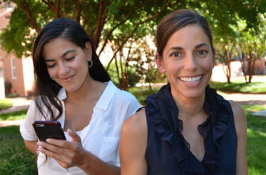 Allison Aiello pictured with a person holding a cellphone.