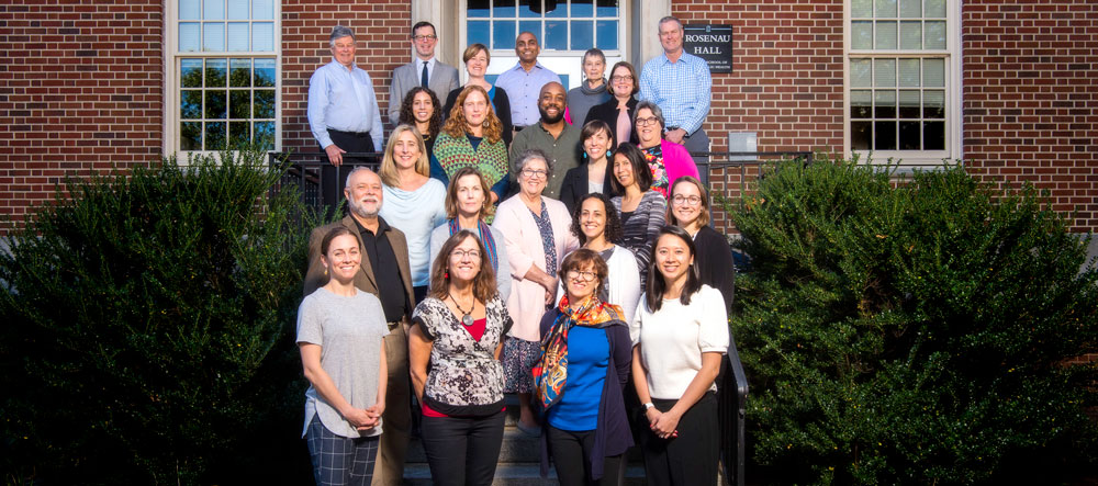 Department of Health Behavior Faculty Members pose for a photo outside of Rosenau Hall.