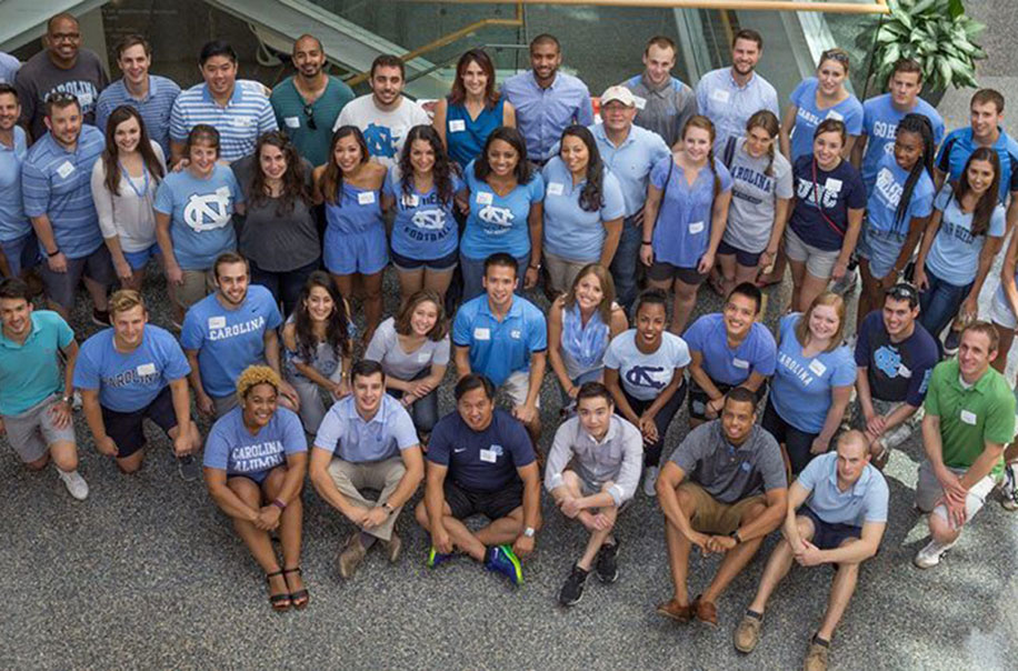 HPM students pose for a photo wearing UNC blue.