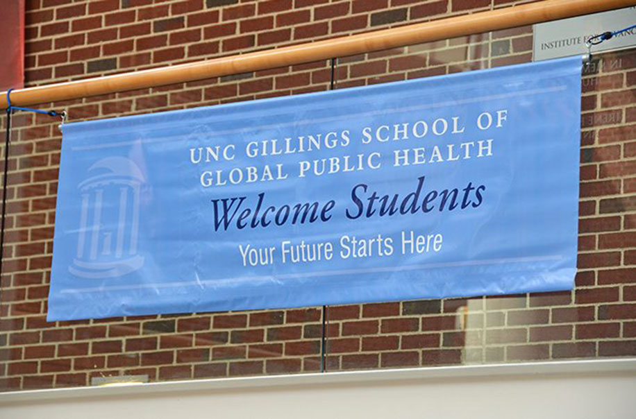 "Pictured is a welcome sign to the Gillings School which reads ""UNC Gillings School of Global Public Health Welcome Students Your Future Starts Here."""