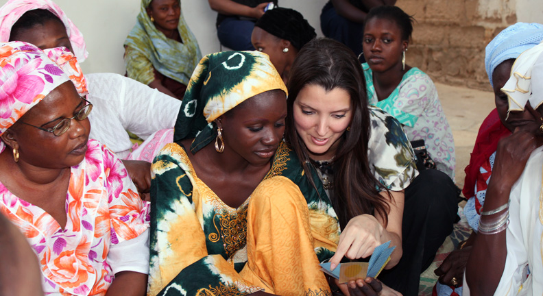 Recent alumna Dr. Layla Lavasani (center, right) worked with women and children in Senegal to improve maternal and child health and nutrition.