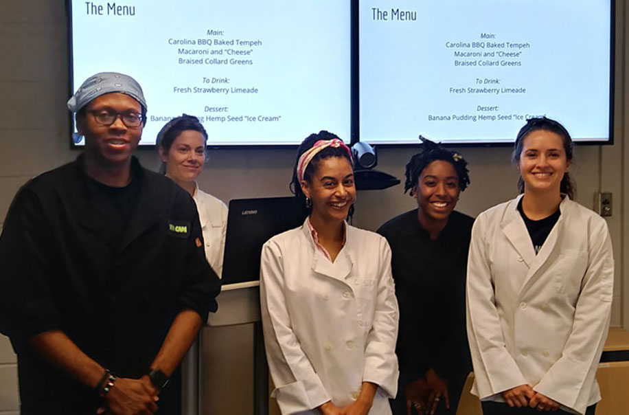 Students pose after presenting a Menu as part of the RD program.