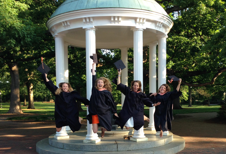 Congratulations MCH graduates! Celebrating at Old Well are Katelyn Bryant-Comstock, Leigh Tally, Macon Lowman and Meg Boatwright.