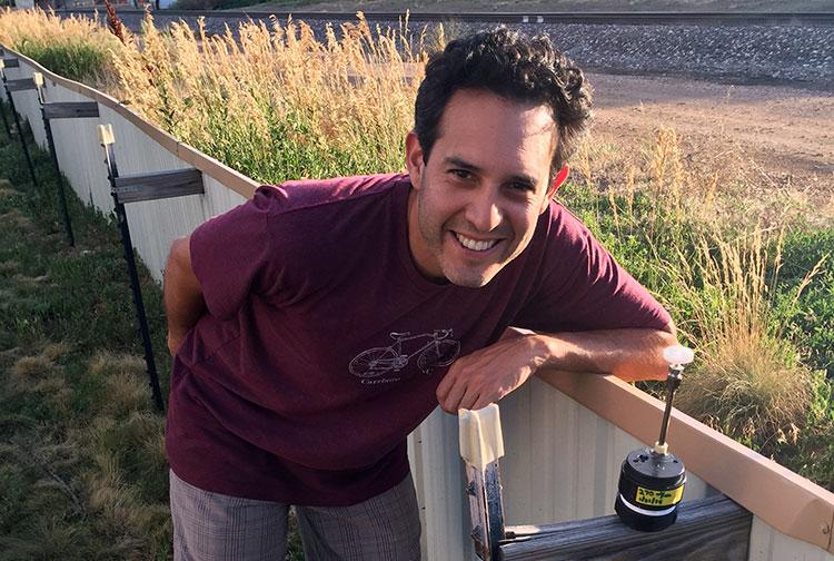 Dr. William Vizuete prepares to take air samples in Boulder, Colo.