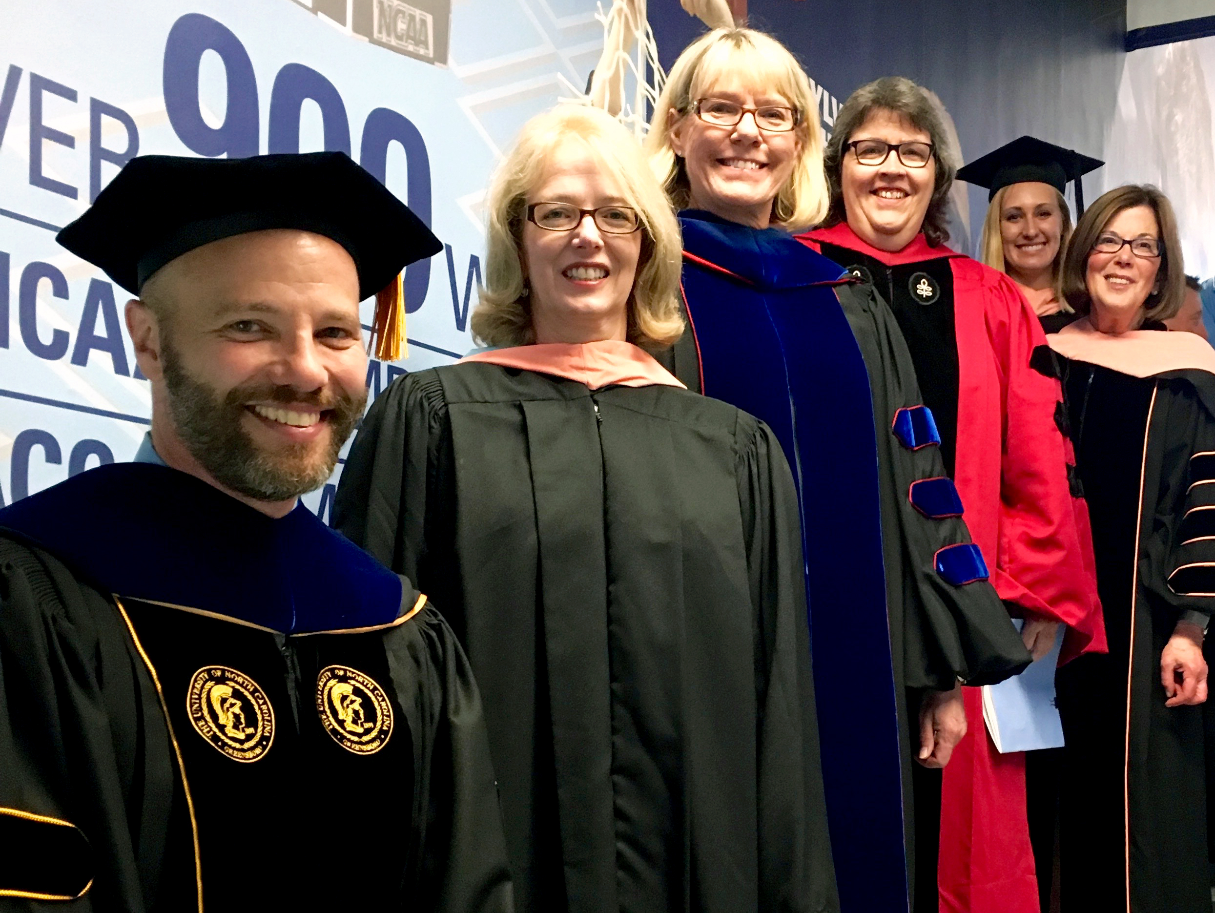 Dr. Nicolet, Paula Brown Stafford, Dr. Halpern, Dr. Linnan, Student Government Co-President Kristin Voltzke and Dean Barbara K. Rimer prepare to take the stage at the School's 2016 Commencement.