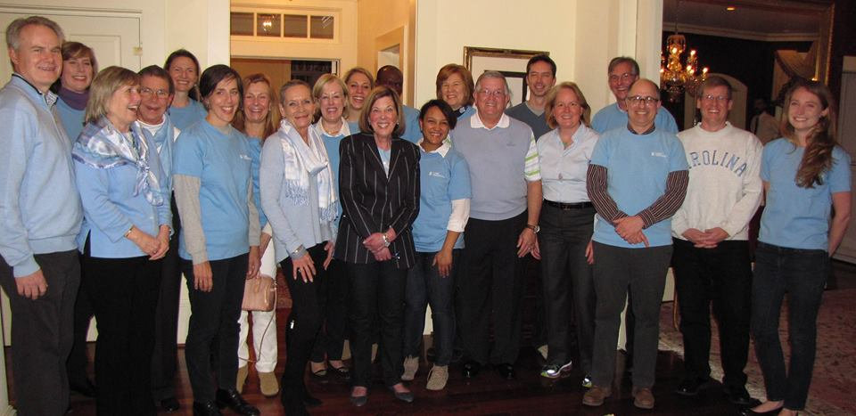 Alumni pose for a photo in Carolina blue.