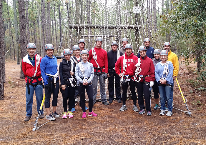 New Hanover Regional Medical Leadership Development members prepare to tackle a ropes course.