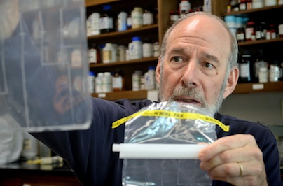 Professor Sobsey demonstrates his award-winning compartment bag water quality test (CBT).
