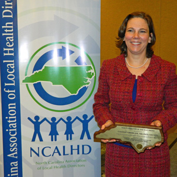 Dr. Colleen Bridger accepts her NCALHD award.