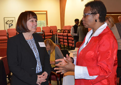 Dr. Peggye Dilworth-Anderson, professor of health policy and management (right), chats with Dr. Barbara Entwisle, UNC's Kenan Distinguished Professor and Vice Chancellor of Research.