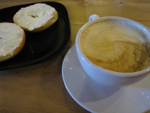 Still Life with Latte and Bagel.  Photo by E. Fernandez