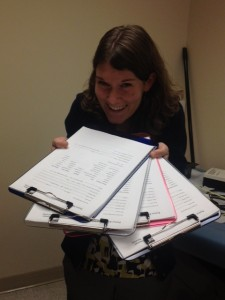 Ashley does not have enough clipboards.  Photo by Brianne Kallam
