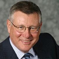 Dr. Dennis Gillings